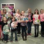 Girl Scout Troop #50214 and Troop #1433 with the Easter Baskets they made to sell. They donated all of the money to Sierra's